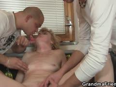 mature-lady-enjoys-two-fresh-cocks
