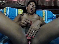 shemale-masturbating-with-a-candy