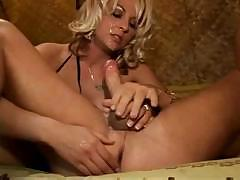 Sindy Lange looks hot sucking his cock and gets a warm facial