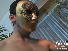 Sexy German slut sucking masked boys in threesome