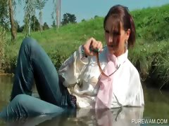 brunette-cutie-gets-wet-in-the-lake