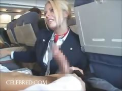 sexy-stew-sucking-and-stroking-dick-on-plane-uniform-blowjob-big-tits-big-cock-handjob-blonde-funny